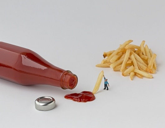 Holding the fries-Adventures Of Tiny People In The World Of Food