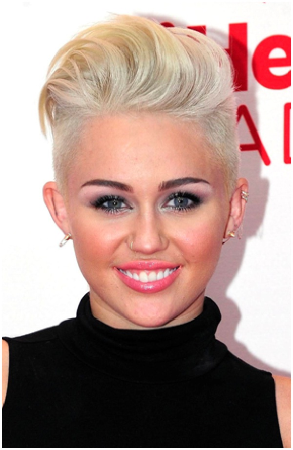 Miley Cyrus-Celebrities Who Are Twitter Addicts