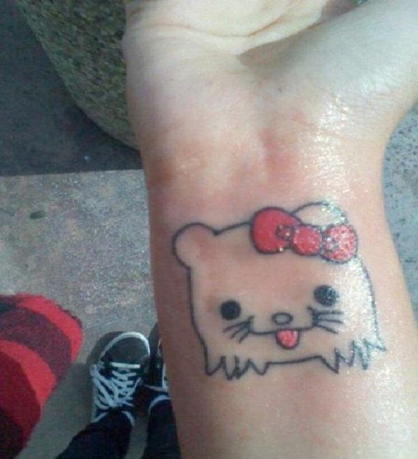 Doggy Kitty-Craziest Hello Kitty Tattoos
