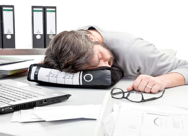 Napping At Your Desk-Hungover At Work Signs