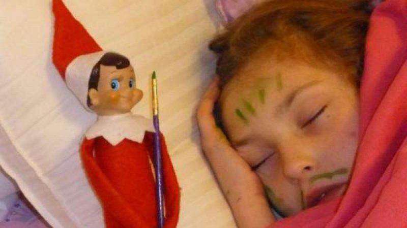 Trolling a Sleeping Girl-15 Hilarious Photos Of The Elf On The Shelf Gone Wrong