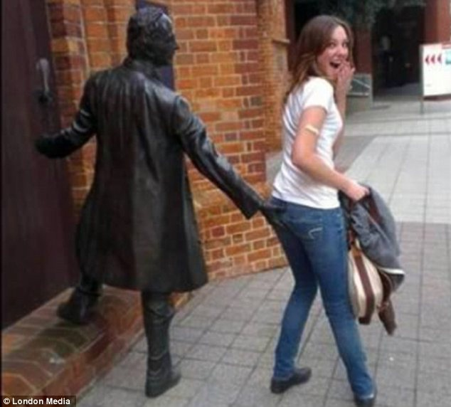 That's just cheeky-People Being Nasty With Statues