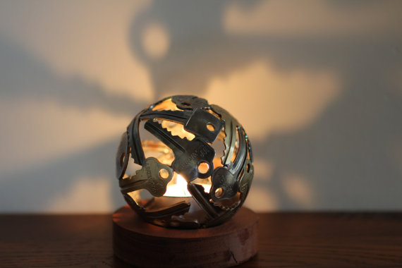 A Small Sphere Shaped Tea Light Holder-15 Beautiful Items That Are Carved Out Of Scrap