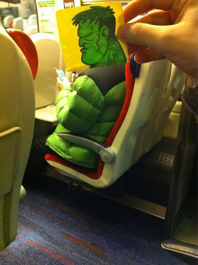 Better not make him angry-Amazing Pics Of Train Passengers With Cartoon Heads By October Jones