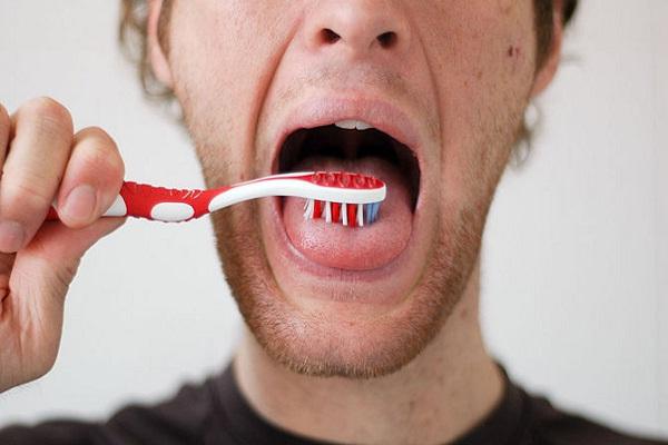 Brush tongue-Natural Ways To Keep Your Teeth Healthy