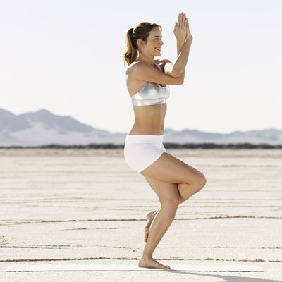 The eagle pose-Simple Yoga Positions To Relieve Stress