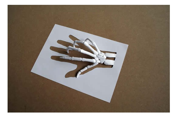 Skeleton hand-Papercut Sculptures From Single Sheet Of A4