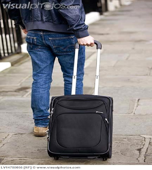 Carrying an empty suitcase-Bizarre New Year Traditions Around The World