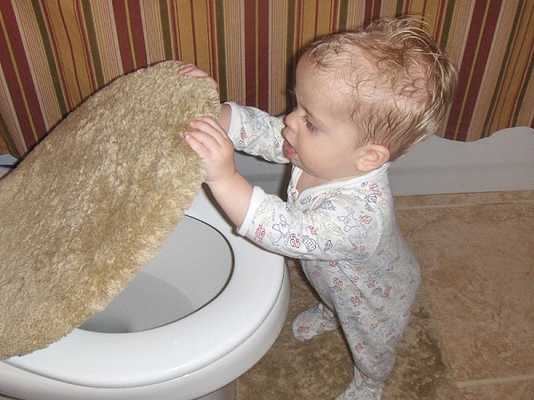 Playing in the toilet-Disgusting Things Done By Kids In Absence Of Parents