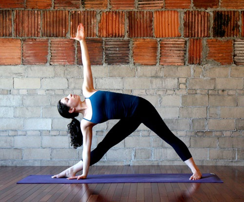 Extended triangle-Simple Yoga Positions To Relieve Stress