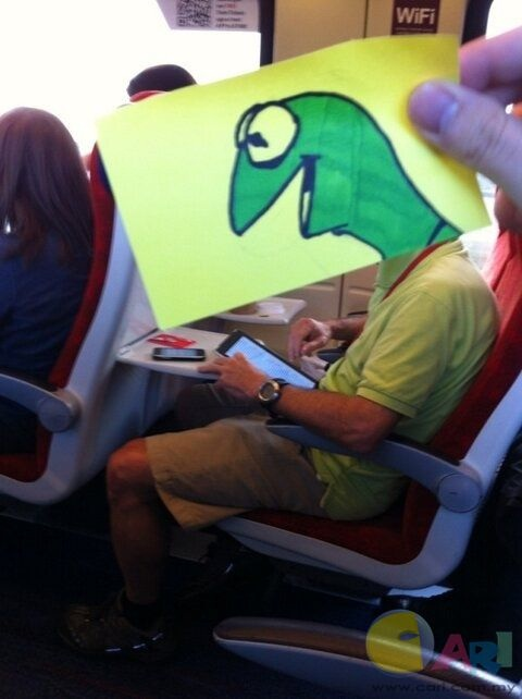 Kermit on his tablet-Amazing Pics Of Train Passengers With Cartoon Heads By October Jones