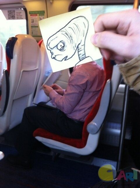 E.T going home-Amazing Pics Of Train Passengers With Cartoon Heads By October Jones
