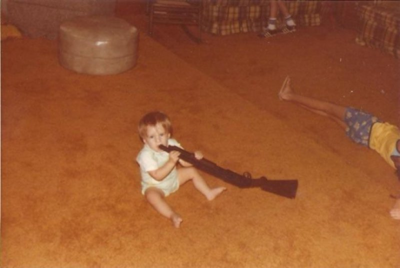 Playing with the Gun-15 Images That Show Parenting Isn't Meant For Everyone