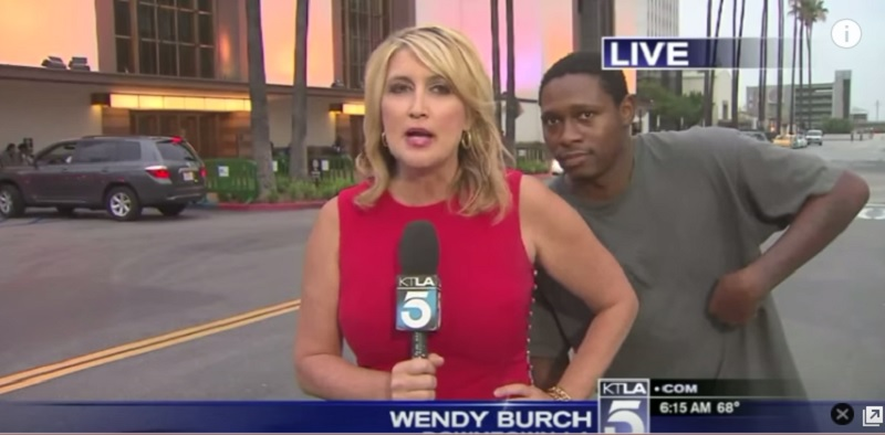She is Slowly Getting Used to Interruptions-15 Funniest News Bloopers Ever
