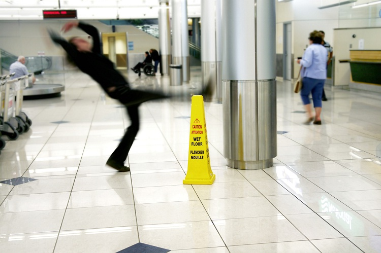 Walking carefully on wet floors-Clumsy People Unable To Do Simple Things