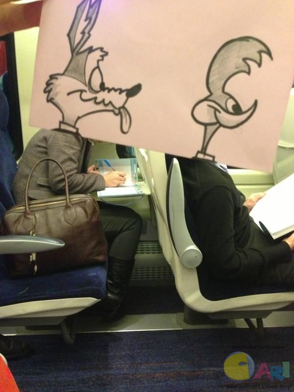 Their eternal chase-Amazing Pics Of Train Passengers With Cartoon Heads By October Jones
