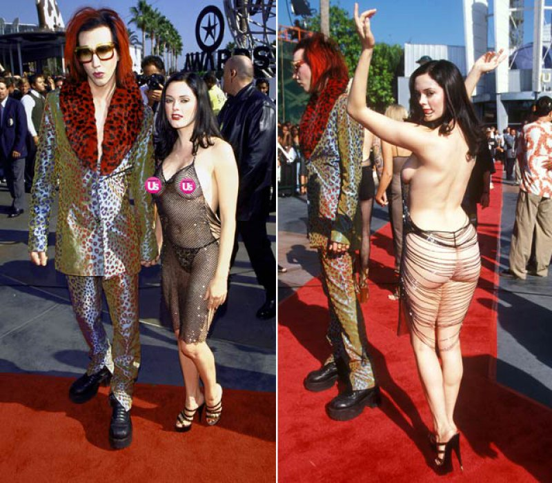 """We can't help but be reminded of Rose McGowan's infamous barely there """"dress"""" that she wore to the VMAs when she went with Marilyn Manson. Admittedly, Rose's skimpy ensemble showed more skin than Amber's."""