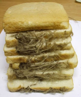 Oven Glove In Loaf Of Bread-15 Most Disgusting Things People Ever Found In Their Food