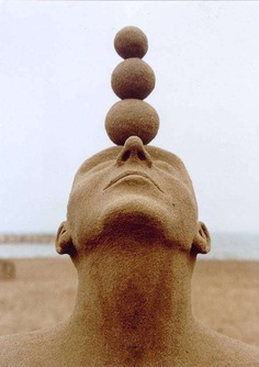 The Balancing Act Sand Sculpture-15 Most Bizarre Sand Art Sculptures Ever Created